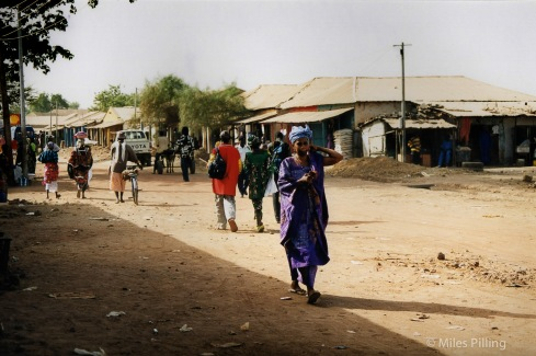 High Street in a Gambian town, during a taxi tyre change stop, The Gambia, 2000