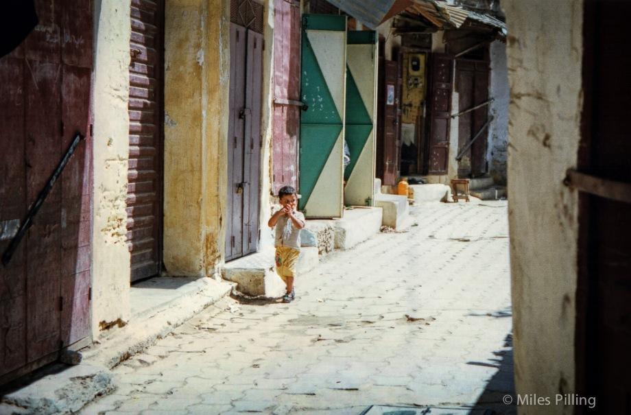 Moroccan boy in deserted street