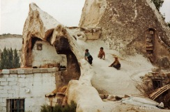 Turkish boys play on the roof of their house near Gorem in the caves of Cappadocia, Turkey, 1992